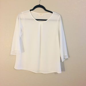Cream colored sheer blouse